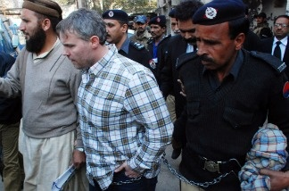 Pakistani police escorted the U.S. consular official, identified by local authorities as Raymond Davis, into court in the city of Lahore.