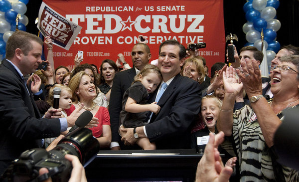 Holding his daughter Caroline, U.S. Senate candidate Ted Cruz and and his wife, Heidi, holding their daughter, Catherine, appear before a cheerful crowd after Cruz defeated Republican rival, Lt. Gov. David Dewhurst in a runoff election  for the U.S. Senate seat vacated by Kay Bailey Hutchison Tuesday, July 31, 2012, in Houston.