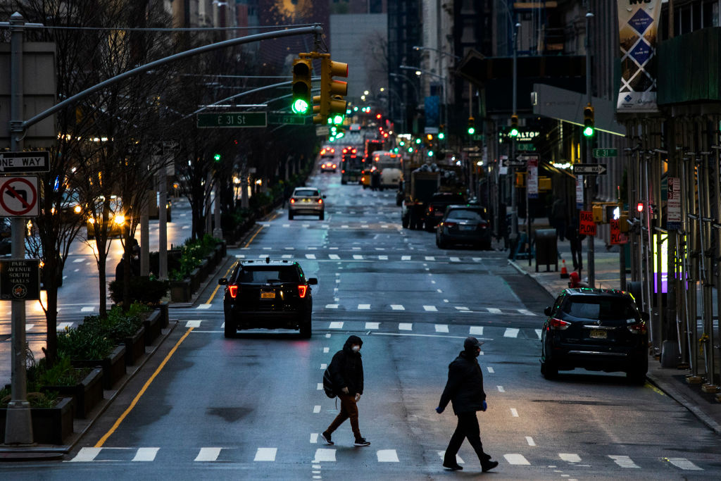 People cross Park Av. after it was announced that some streets will be shut as lockdown continues in response to the coronavirus (COVID-19) outbreakon March 27, 2020 in New York City.