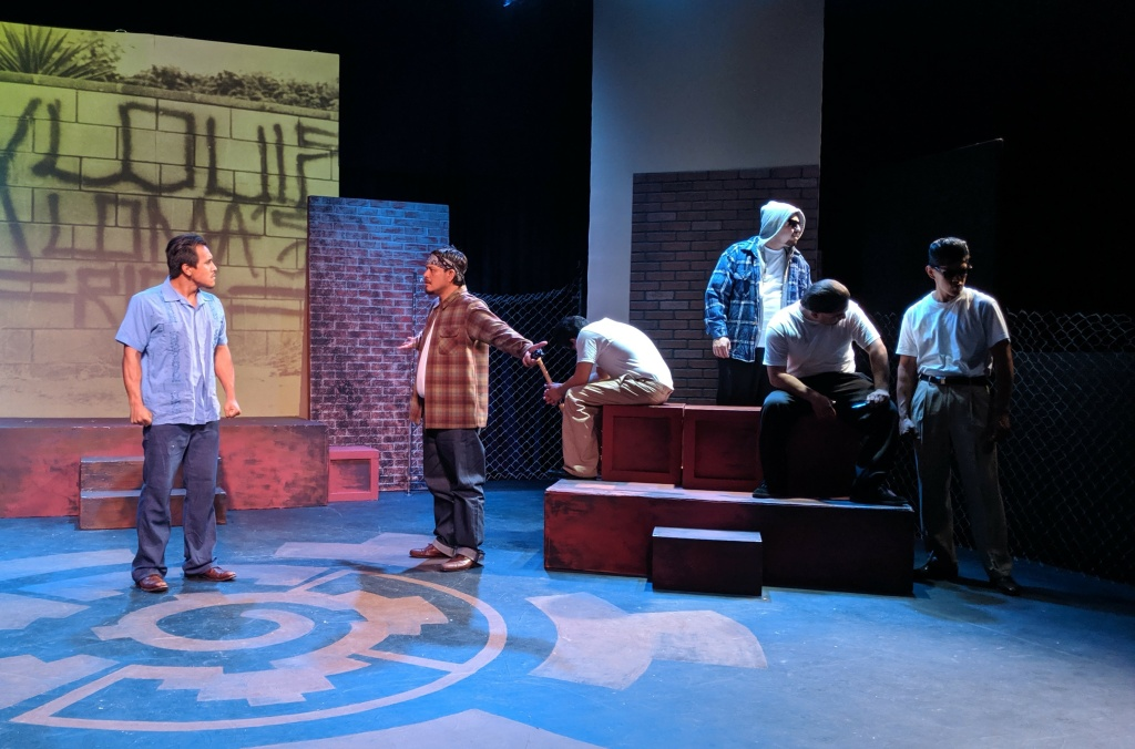The lead character, Luis J. Rodriguez is played by Rufino Romero (pictured on the far-left) in a scene of the new play 'Always Running.' The play is based on the life of the playwright as a former gang member.