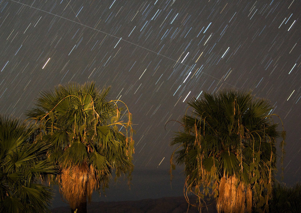 Perseid meteors streak across the sky near Rogers Spring in the Lake Mead National Recreation Area, Nevada in August 2008. The meteor display, known as the Perseid shower because it appears to radiate from the constellation Perseus in the northeastern sky, is a result of Earth's orbit passing through debris from the comet Swift-Tuttle.