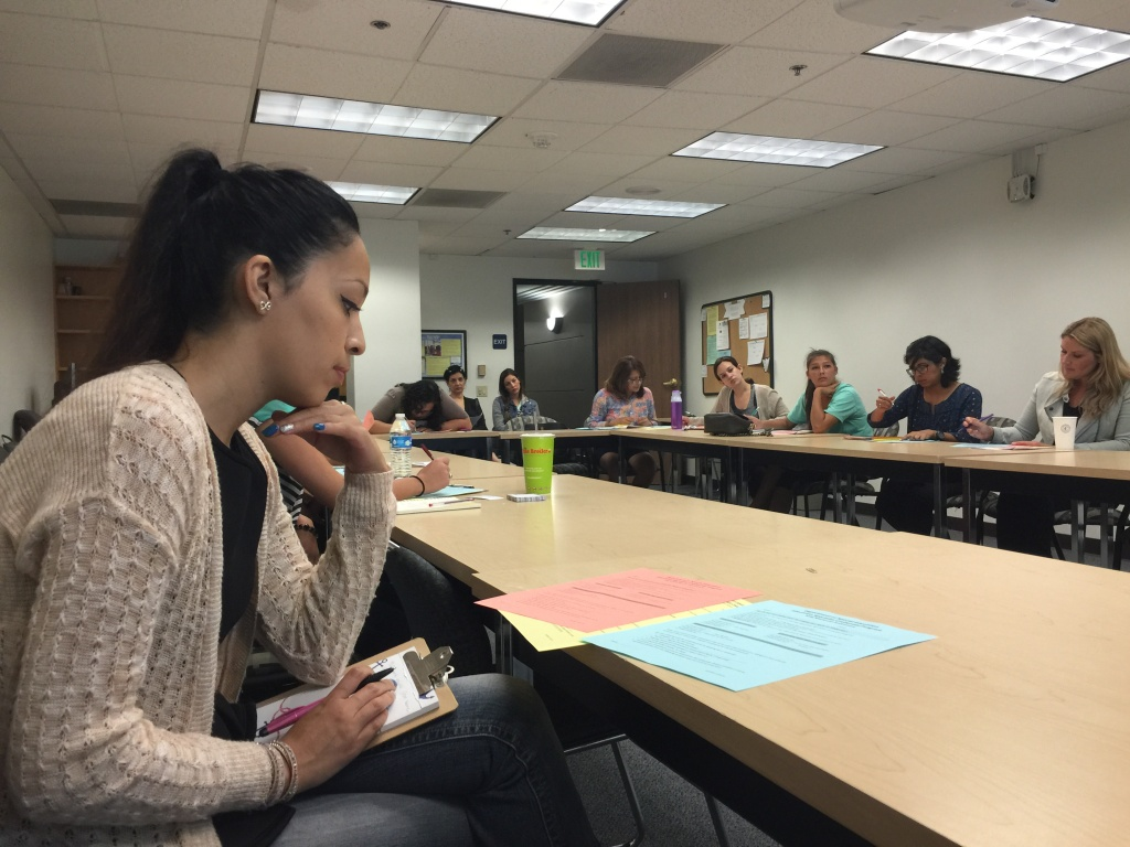 Women at Cal State Fullerton attend a recruiting event. The state is facing a shortage of teachers, in part due to declining enrollment in teacher prep programs.