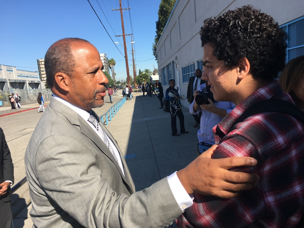 University of California, Irvine Vice Chancellor Thomas Parham, left, talks to Compton High School senior Anthony Ibarra about programs to help him get admitted to a U.C. campus.