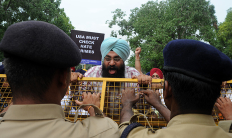 Activists of the Shiromani Akali Dal shout anti-US slogans during a protest near the U.S. embassy in New Delhi on Monday, August 6, 2012.