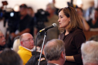 Geisha Williams, center, senior VP of Energy Delivery for Pacific Gas & Electric, spoke to hundreds of displaced San Bruno residents that jammed a town hall meeting at St. Roberts Catholic Church in San Bruno, Calif., Saturday, Sept. 11, 2010. Fire crews doused the remnants of an enormous blaze and accounted for the residents of dozens of homes Friday after a gas line ruptured and an explosion ripped through in a neighborhood near San Francisco, killing at least six people.