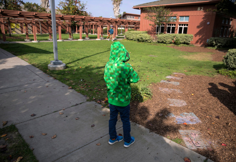 A child stands on the grounds of the Casa Pacifica Centers for Children and Families in Camarillo (Ventura County)