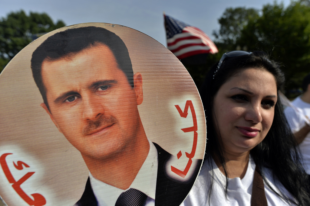 Supporters of Syrian President Bashar Al-Assad take part in a demonstration in front of the White House in Washington, DC, on September 9, 2013 urging US not to attack Syria.