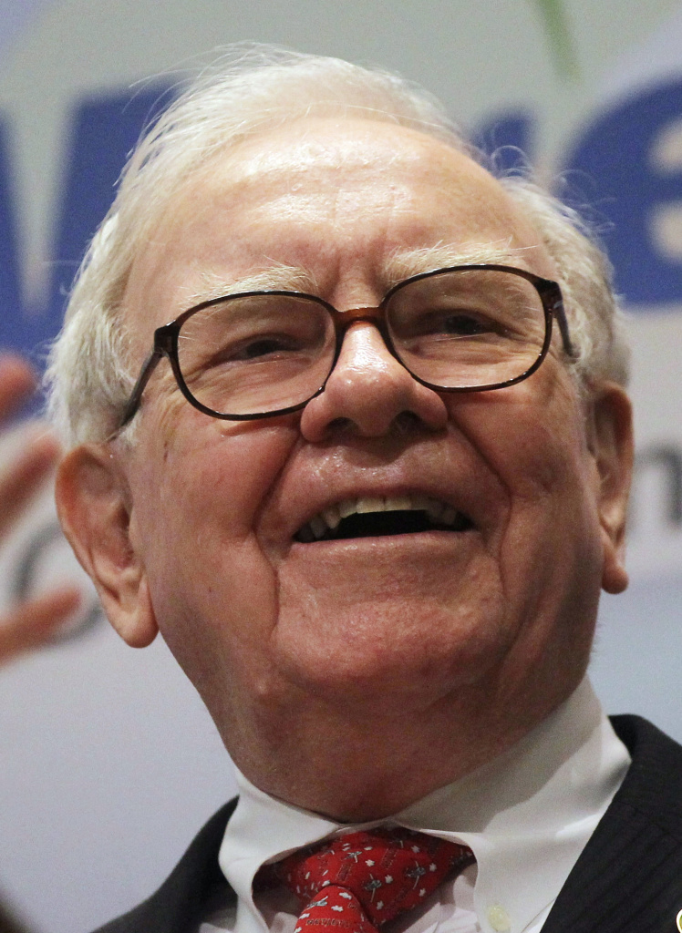 Berkshire Hathaway Inc. Chairman and CEO Warren E. Buffett smiles at the New York Stock Exchange before ringing the opening bell on September 30, 2011 in New York City. U.S. President Barack Obama's new plan for a higher tax rate for millionaires has been dubbed the