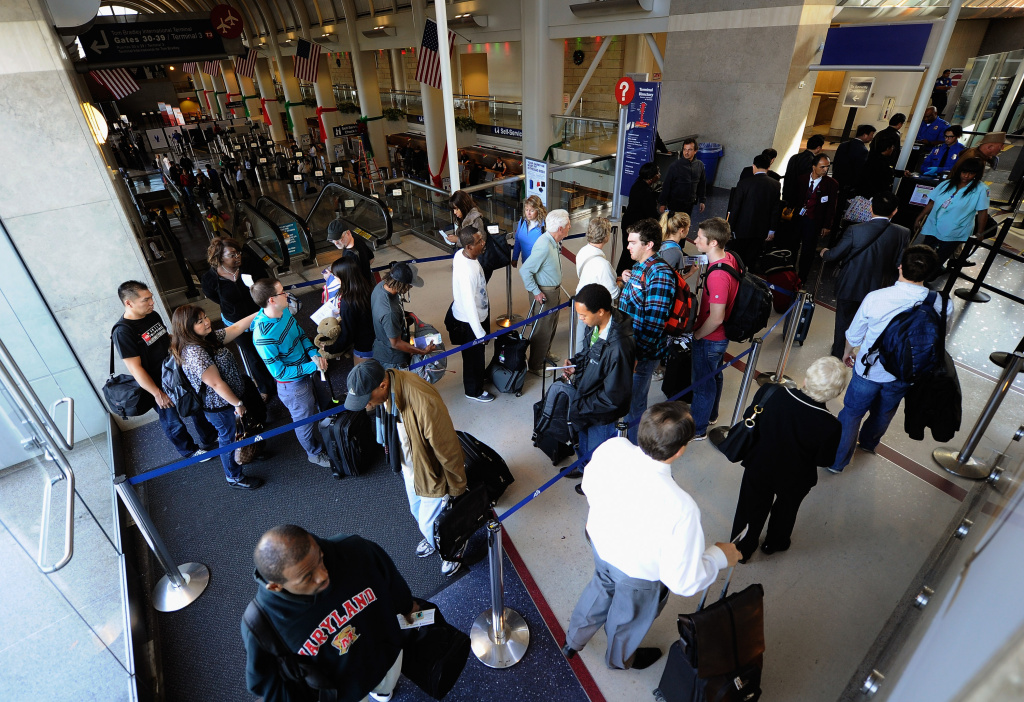 Travelers wait in line to have their boarding passes checked at a security screening area of American Airlines terminal at Los Angeles International Airport (LAX) on November 23, 2011 in Los Angeles, California.