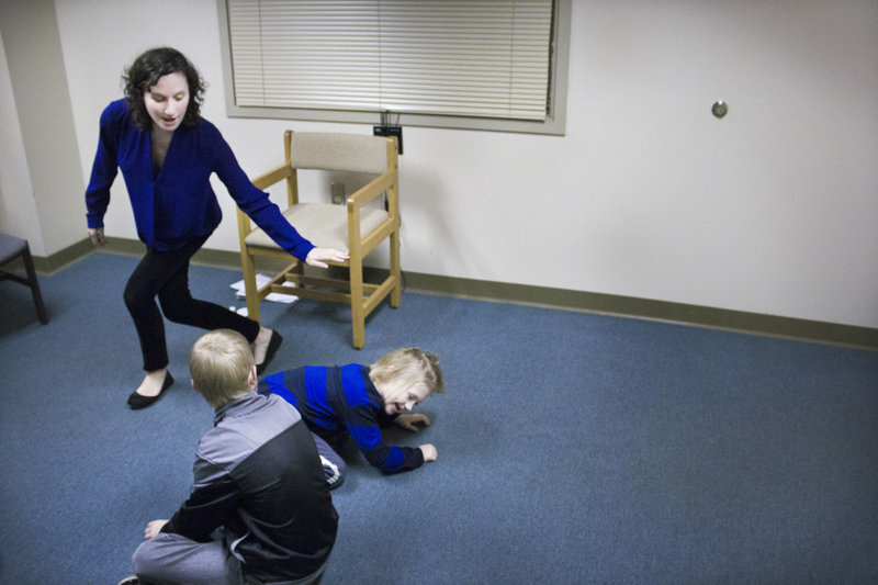 The improv theater class at Indiana State University's psychology clinic. Rachel Magin (standing) created the class to help children with autism learn social skills and practice reading others' emotions.