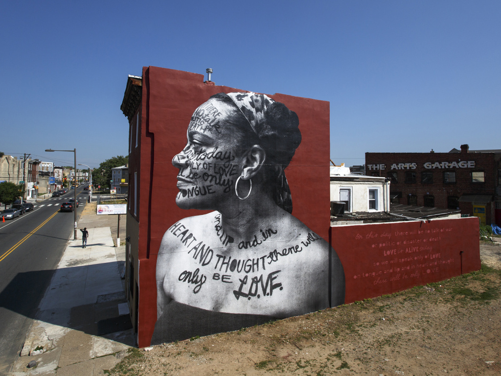 A Philadelphia mural entitled <em>You Go Girl </em>by Jetsonorama and Ursula Rucker. This is just one of many murals that the city's Mural Arts Program helped to create.