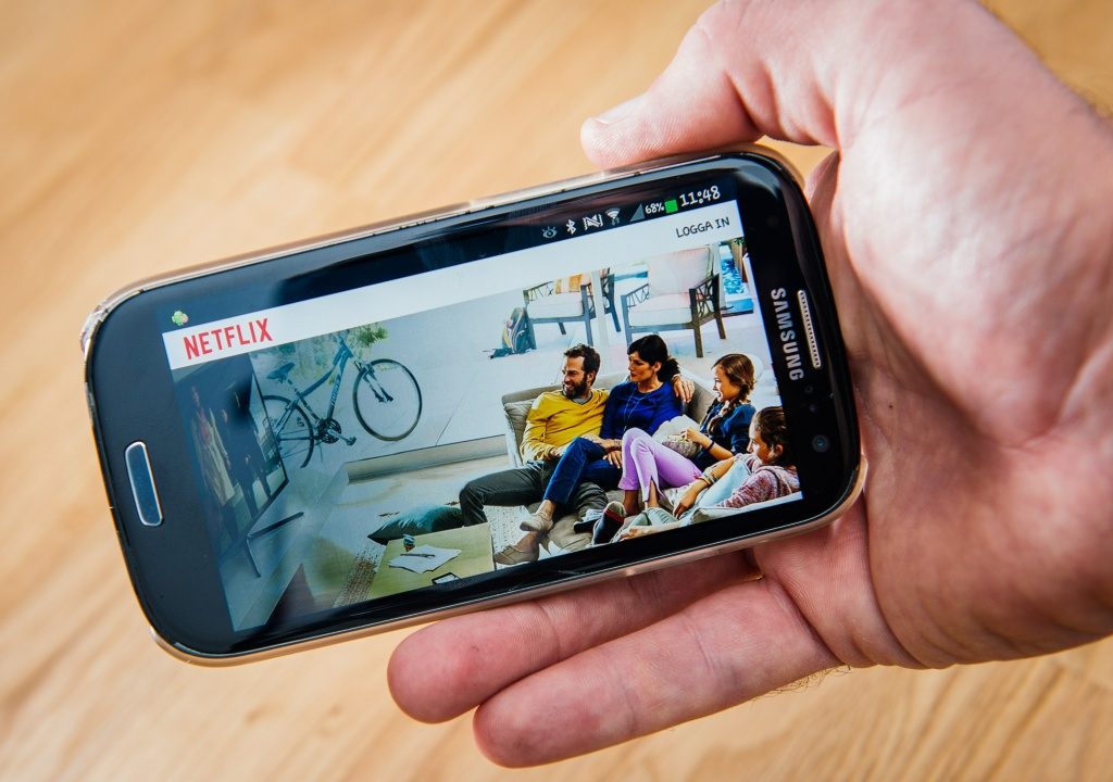 This picture taken on September 11, 2014 shows the on-demand internet streaming media provider, Netflix, on a smartphone.