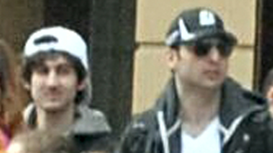 Soon after authorities distributed this image of Dzhokhar (at left) and Tamerlan Tsarnaev near the finish line of the Boston Marathon just before bombs exploded there, the brothers allegedly killed an MIT police officer, carjacked a vehicle and engaged in a gun battle with police. Tamerlan, 26, died from injuries he received. Dzhokhar, 19, was captured Friday night.
