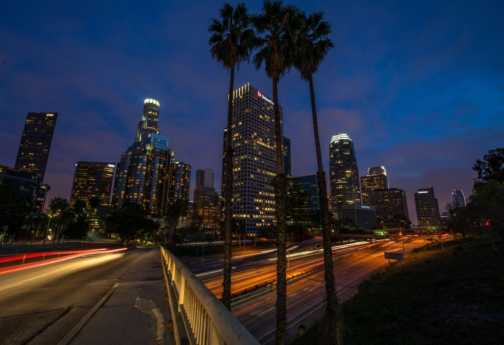 Sunday traffic moves on Interstate Highway 110 at dusk through downtown of Los Angeles on March 23,2014.AFP PHOTO/JOE KLAMAR        (Photo credit should read JOE KLAMAR/AFP/Getty Images)