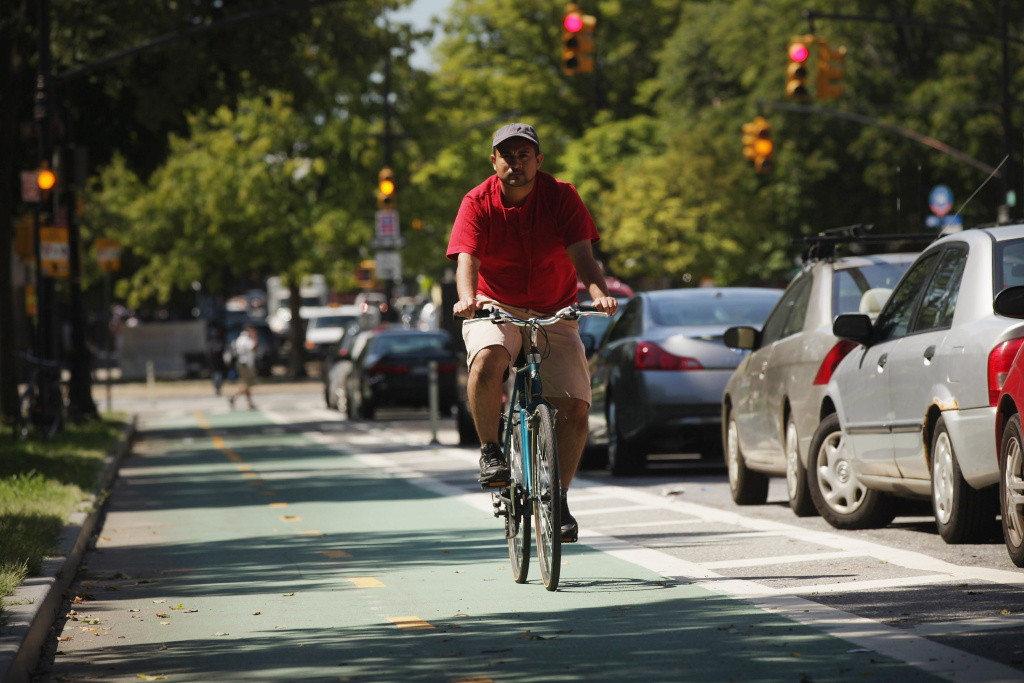 A man rides his bike along a controversial bike lane on Prospect Park West on August 17, 2011 in the Brooklyn borough of New York City.