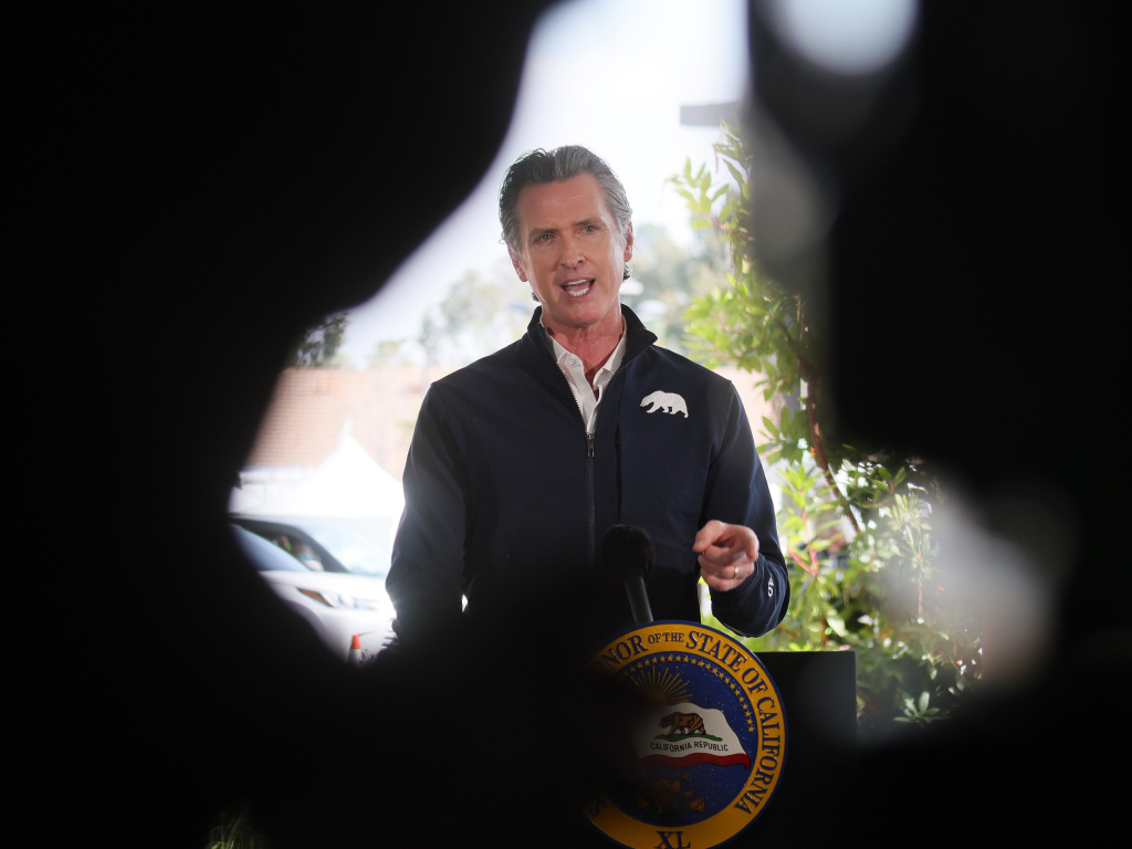 California Governor Gavin Newsom speaks at a press conference following the opening of a new large scale COVID-19 vaccination site in Los Angeles on Tuesday. Newsom says the state will start setting aside 10% of its vaccine allotment for teachers, day care workers and other school employees.