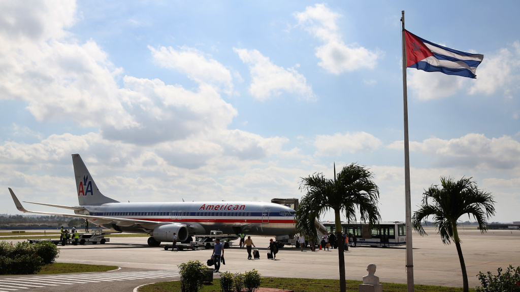 Passengers walk across the tarmac at Jose Marti International Airport after arriving on a charter plane operated by American Airlines January 19, 2015, in Havana, Cuba. The Department of Transportation has approved scheduled flights from the U.S. to Cuba, including some operated by American — though no flights to Havana have yet been authorized.