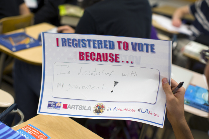 Senior Christophe Saucier hands back his completed voter registration form during a student voter drive at North Hollywood High School. The drive was put on by the Los Angeles County Clerk, Arts for LA and the United Way.