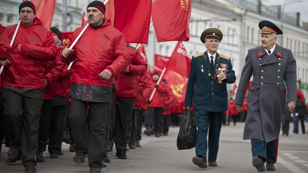 Russia has vetoed a U.N. Security Council resolution that would invalidate Sunday's referendum in Crimea. In Moscow, demonstrators and military veterans march in support of the Kremlin Saturday; nearby, a large march was held to protest Russia's policies.