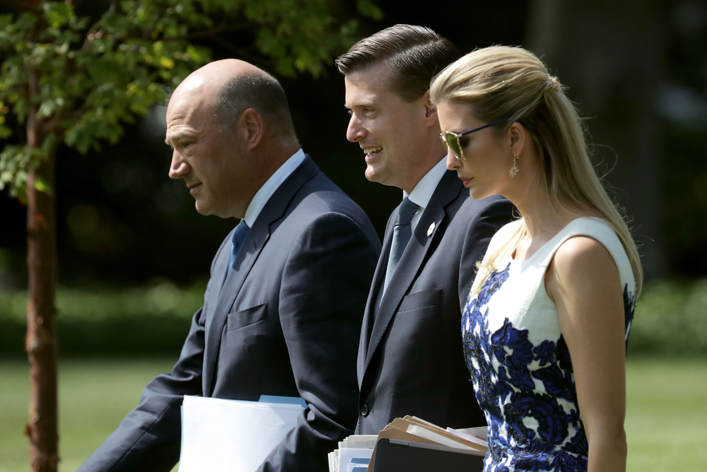 National Economic Council Director Gary Cohn (left), White House Staff Secretary Rob Porter (center) and Ivanka Trump walk across the South Lawn of the White House on August 30, 2017.