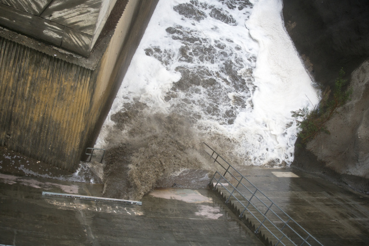 Water flows at Devil's Gate Dam in Pasadena on Tuesday morning, Sept. 15, 2015. Rainfall reached record levels in areas of Los Angeles.