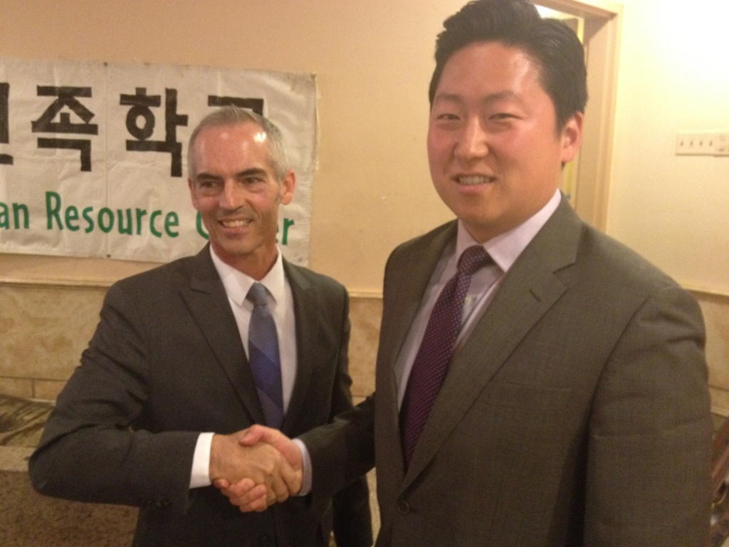 The CD13 race between Mitch O'Farrell, left, and John Choi isn't as friendly as it looks here. Allegations of voter fraud and xenophobia have surfaced in recent days.