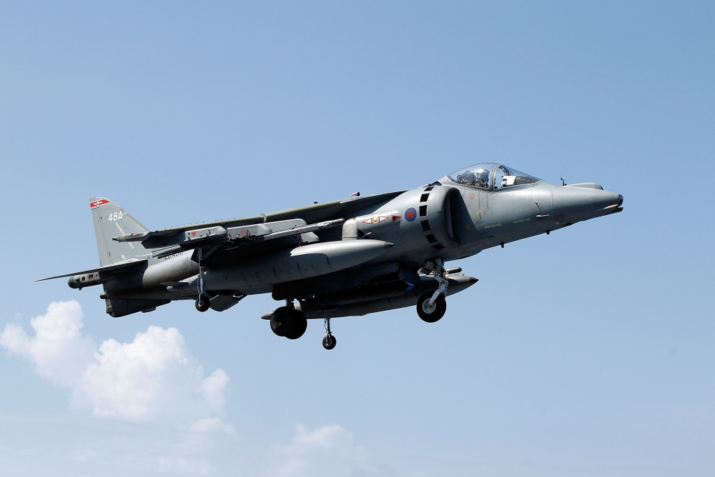 File: A Harrier jet of 1(F) Joint Force Squadron hovers as it comes in to land on the flight deck of HMS Ark Royal during Exercise Auriga on July 14, 2010 at sea in Onslow Bay near North Carolina.