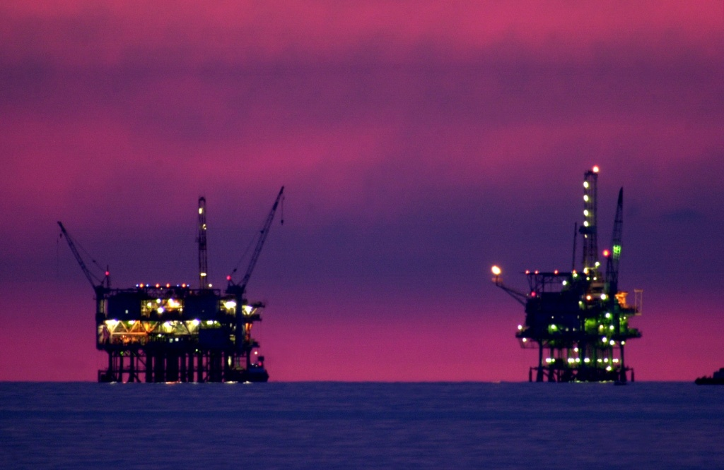 385757 05: Night comes to the Hogan, left, and Houchin oil and gas platform near the Federal Ecological Reserve in the Santa Barbara Channel, February 16, 2001, near Santa Barbara, CA. In recent months the state Coastal Commission has argued against the federal government in its lawsuit over offshore oil exploration, a case that could lead to more drilling near a marine sanctuary or leave up to 1 billion barrels of oil untapped. The tourism-heavy area relies on its coast to attract visitors and has been sensitive to oil drilling since a 3.3 million gallon spill from a platform in 1969 spawned an anti-drilling movement. (Photo by David McNew/Newsmakers)