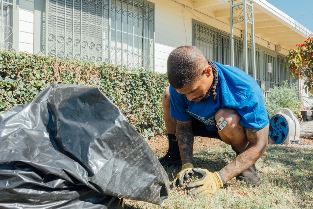 Volunteers with The Mission Continues helped spruce up the landscaping at Gonzaque Village in Watts.
