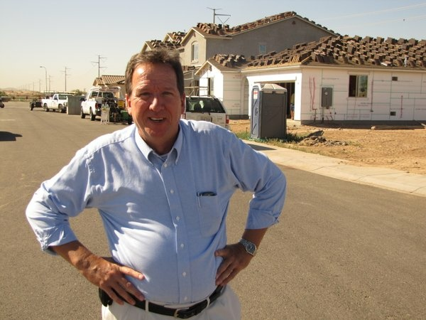 When Realtor Greg Swann visited this subdivision in West Phoenix two years ago, there was no new construction happening. Now, workers build about a dozen new homes behind him.