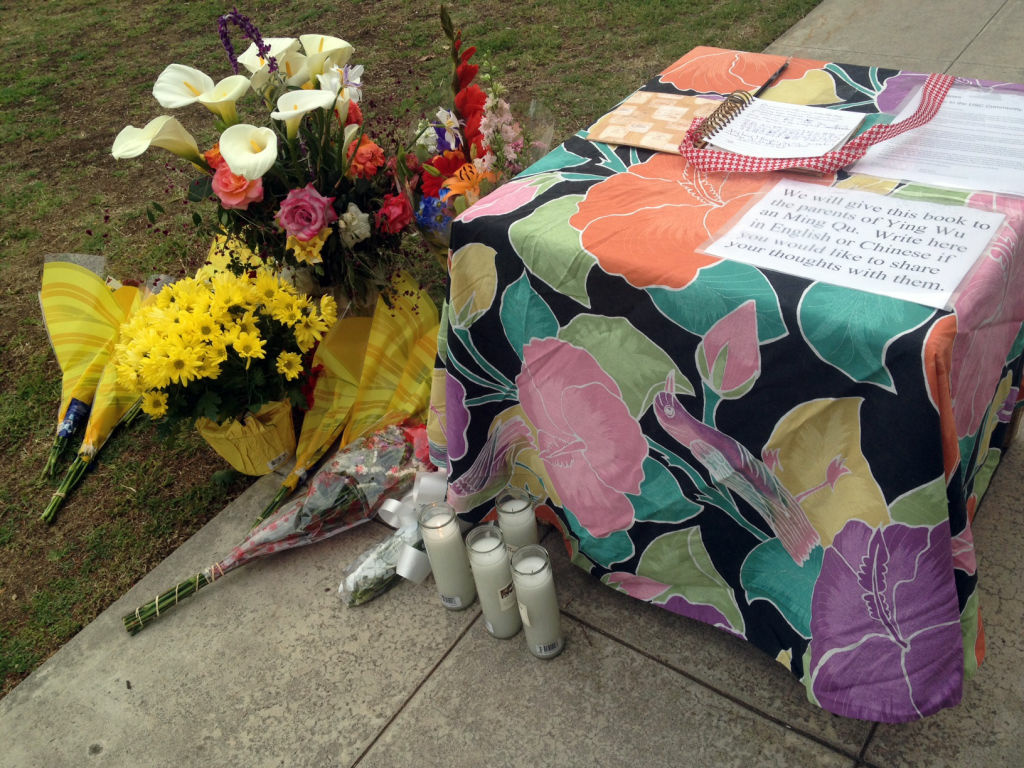 Students and neighbors brought flowers to the house where one of the victims lived. Two USC graduate students were shot and killed, April 11, 2012.
