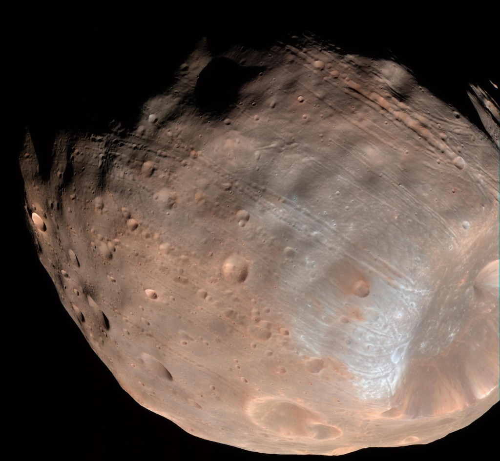 The grooves on Mars' moon Phobos could be produced by tidal forces – the mutual gravitational pull of the planet and the moon, says NASA. The theory is the latest explanation for grooves that were once thought to result from the massive impact that caused the Stickney crater (lower right).