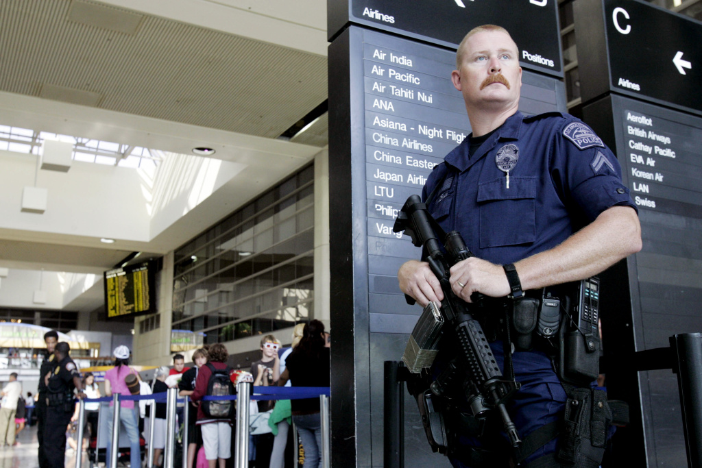 Los Angeles Airport Police officer James Adrian stands on watch at Los Angeles International Airport in August 2006.