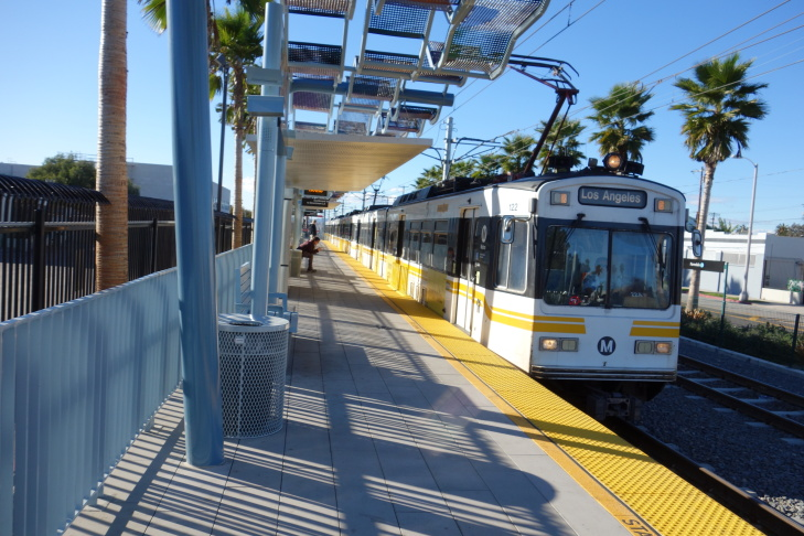 An Expo Line train heads out of Pico Station near Downtown Los Angeles toward Culver City.
