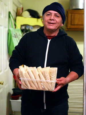 Ofelio Crespo makes tamales in his home on Dec. 20.