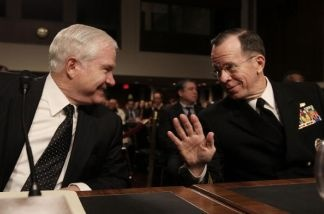Defense Secretary Robert Gates (L) and Chairman of the Joint Chiefs of Staff Adm. Michael Mullen (R) participate in a Senate Armed Services Committee hearing on Capitol Hill on February 2, 2010 in Washington, DC.