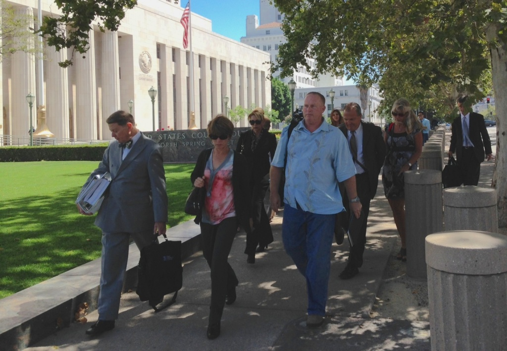 Defendants in a case against Los Angeles Sheriff's Department employees, their attorneys and their supporters leaving court on Tuesday, July 1, 2014.