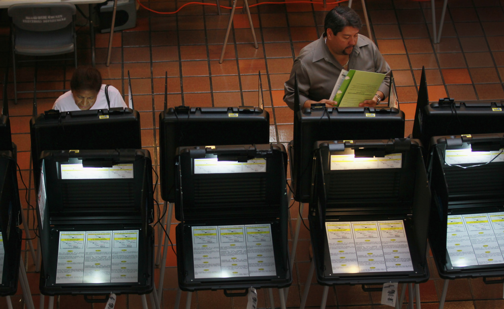 Early voters fill out their ballots as they cast their votes before the general election in Miami, Florida.