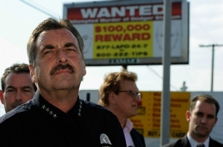 Los Angeles Police Department police chief Charlie Beck (L) standing in front of one of 300 billboard showing a 'wanted' poster for two suspects wanted for the beating of a San Francisco Giants fan Bryan Stow speaks during a news conference on May 17, 2011 in Los Angeles, California.