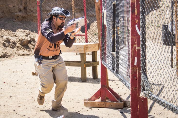 Claudia Vidanes aims a Phantom Strike AR-15, a custom gun designed by her father Jojo Vidanes, president of the Norco Running Gun club.