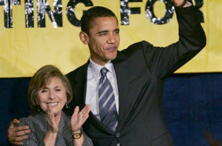 Presidential candidate Sen. Barack Obama, D-Ill., right, waves as Sen. Barbara Boxer, D-Calif., left, smiles during her re-election campaign reception in San Francisco, Monday, Feb. 19, 2007.
