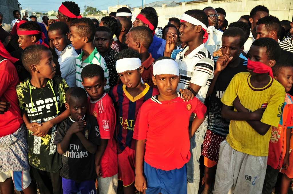 People wear headbands as a sign of anger as they protest after a truck bomb exploded outside of the Safari Hotel in Mogadishu on October 15, 2017.