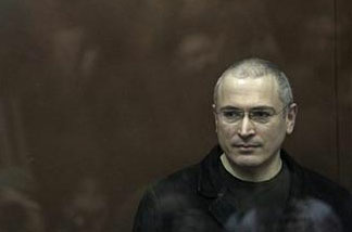 Mikhail Khodorkovsky stands behind bars at a court room in Moscow, Monday, Dec. 27, 2010.