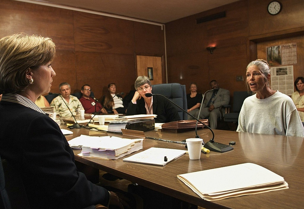 Sheron Lawin (L), a member of the Board of Prison Terms commissioners, listens to Leslie Van Houten (R), after her parole was denied 28 June 2002 at the California Institution for Women in Corona, California. Van Houten, 53, has served over 30 years in prison for her involvement in the Tate-LaBianca killings.