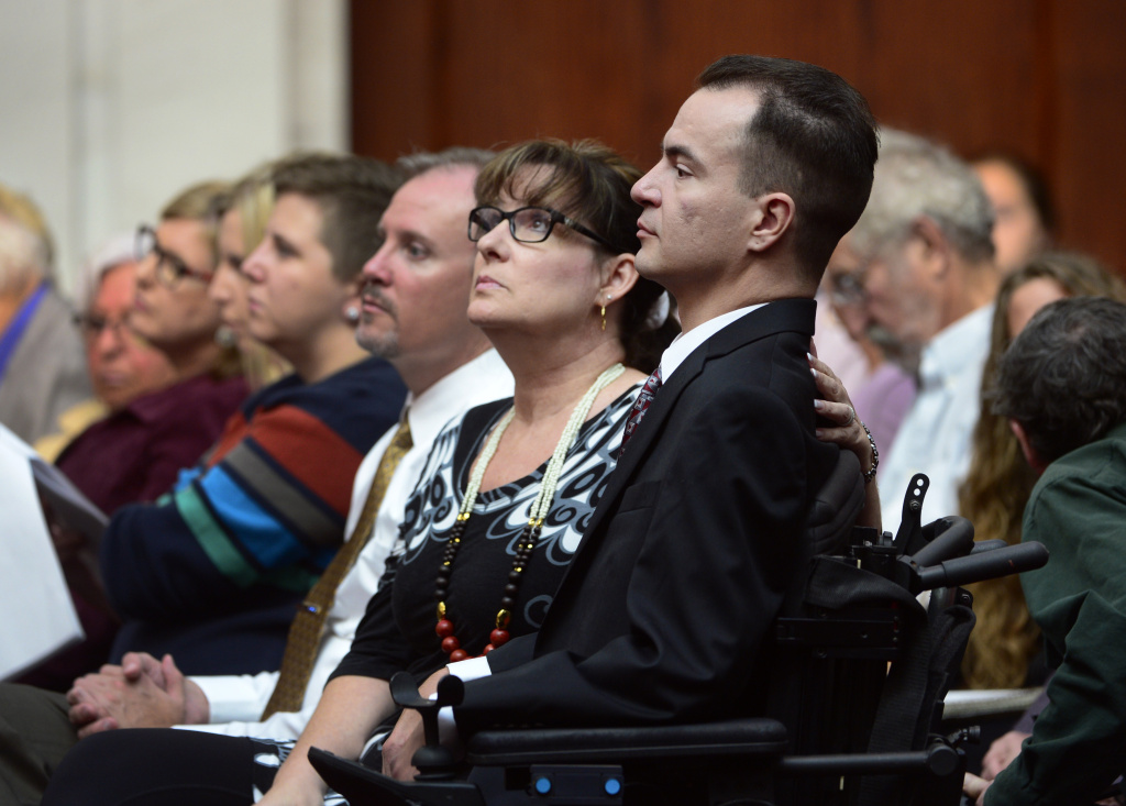 Brandon Coats, a quadriplegic medical marijuana patient who was fired by the Dish Network after failing a drug test more than four years ago, right, waits for the proceedings to begin with his mother, Donna Scharfenberg, at the Colorado Supreme Court in Denver in this file photo taken on Tuesday, Sept. 30, 2014. The state Supreme Court ruled Monday, June 15, 2015, that Coats cannot get his job back.