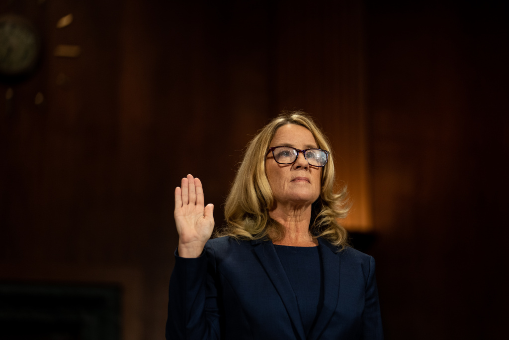 Christine Blasey Ford is sworn in prior to giving testimony before the U.S. Senate Judiciary Committee at the Dirksen Senate Office Building on Capitol Hill September 27, 2018 in Washington, DC.