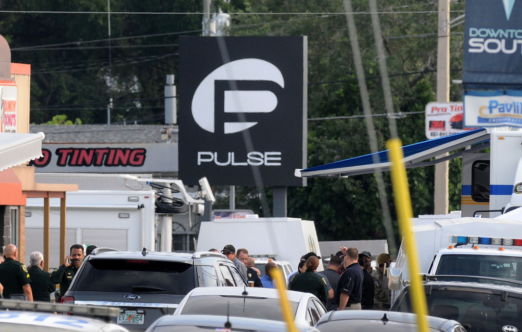 Orlando police officers seen outside of Pulse nightclub after a fatal shooting and hostage situation on June 12, 2016 in Orlando, Florida. The suspect was shot and killed by police.
