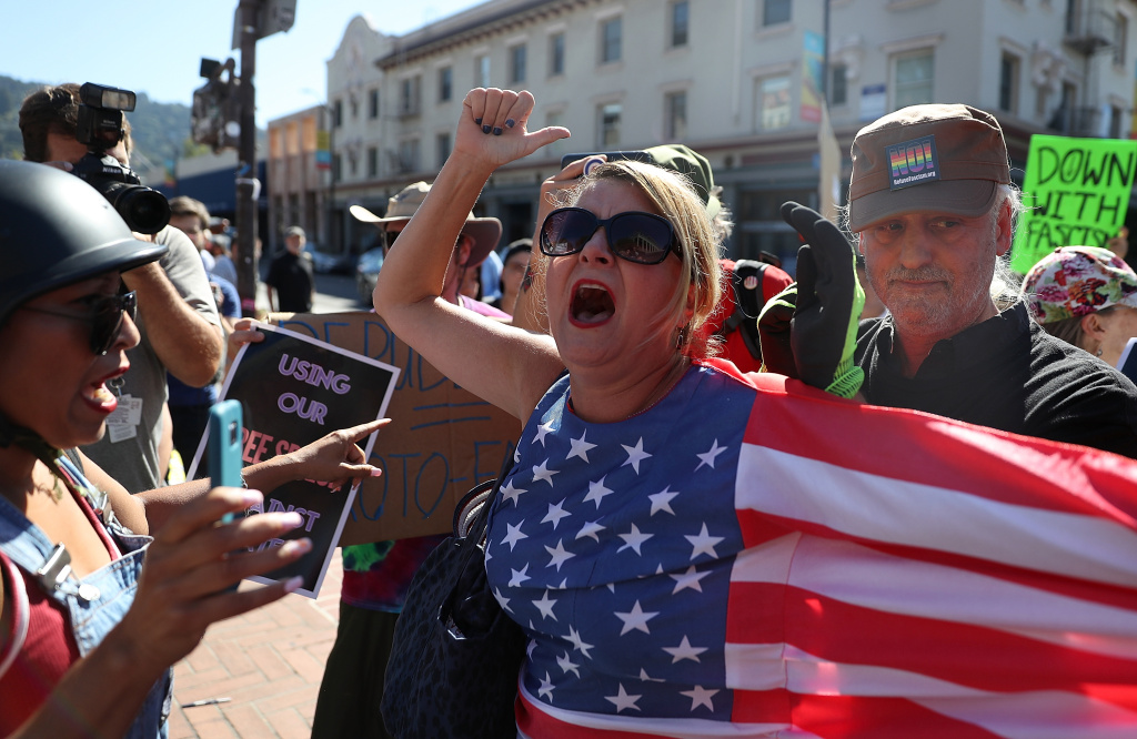 BERKELEY, CA - SEPTEMBER 24:  Protesters shout at each other during a free speech rally with right wing commentator Milo Yiannopoulos at U.C. Berkeley on September 24, 2017 in Berkeley, California. Hundreds of protesters came out to support and demonstrate against Milo Yiannopoulos as he held a free speech rally at U.C. Berkeley.  (Photo by Justin Sullivan/Getty Images)
