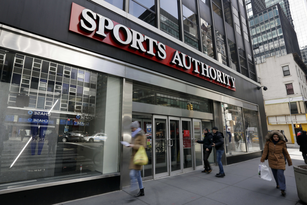 People enter a Sports Authority store, in New York, Wednesday, March 2, 2016. Sports Authority is filing for Chapter 11 bankruptcy protection. The Englewood, Colo., company has 463 stores in 41 states and Puerto Rico.