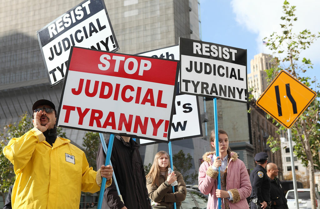 Supporters of Prop 8 holds a sign during a demonstration outside of the Ninth Circuit Court of Appeals on December 6, 2010 in San Francisco, California.